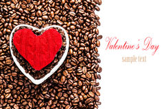 Roasted Coffee Beans with Red Heart over coffee beans background. Isolated on white  with copy space. Love Coffee at Valentine's Day.  Wedding, love, holiday Stock Image