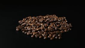 Roasted Coffee Beans Rotate on black background Stock Photography