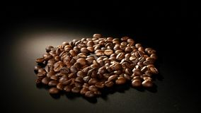 Roasted Coffee Beans Rotate on black background Royalty Free Stock Photos