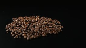 Roasted Coffee Beans Rotate on black background Royalty Free Stock Photography
