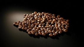 Roasted Coffee Beans Rotate on black background Stock Image