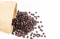 Roasted coffee beans from sack bag Royalty Free Stock Image