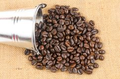 Roasted coffee beans on sack cloth Stock Photography