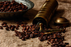 Roasted coffee beans on sack Stock Images