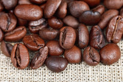 Roasted coffee beans on sackcloth Royalty Free Stock Images