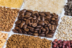 Roasted coffee beans in set of groceries Stock Photography
