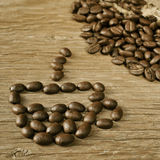 Roasted coffee beans in the shape of a cup of coffee Stock Images