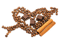 Roasted coffee beans in shape of heart with cupid arrow, chocolate cubes, cinnamon stick, isolated on white background. Stock Image