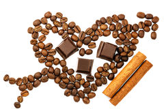 Roasted coffee beans in shape of heart with cupid arrow, chocolate cubes, cinnamon stick, isolated on white, top view. Stock Images