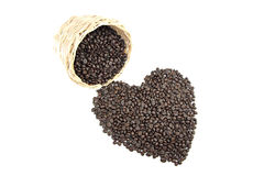 Roasted coffee beans that is shaped like heart. Stock Photo