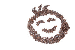 Roasted coffee beans in smile face shape Royalty Free Stock Images