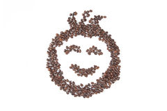Roasted coffee beans in smile face shape Royalty Free Stock Photos