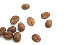Roasted coffee beans. Some flavored coffee beans closeup on white background Royalty Free Stock Photos