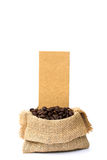 Roasted coffee beans spilled on pile and in burlap sacks Stock Photography