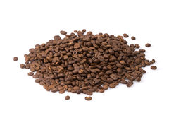 Roasted coffee beans spilled on a white background. Royalty Free Stock Photos