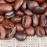 Roasted coffee beans on textile Stock Photos