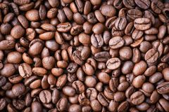 Roasted coffee beans texture background / Close up coffee bean top view royalty free stock photography