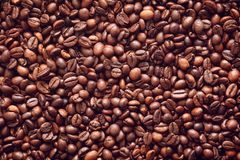 Roasted coffee beans texture background stock photo