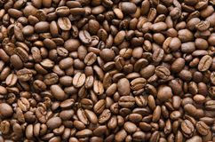 Roasted coffee beans texture. Brown grain background Stock Image