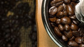 Roasted coffee beans vintage mood be used as a background. The roasted coffee beans vintage mood be used as a background Stock Photography