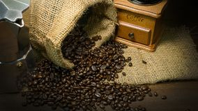 Roasted coffee beans vintage mood be used as a background. The roasted coffee beans vintage mood be used as a background Royalty Free Stock Images