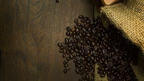 Roasted coffee beans vintage mood be used as a background. The roasted coffee beans vintage mood be used as a background Stock Image
