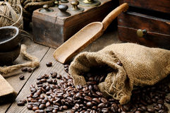 Roasted coffee beans in vintage setting Stock Photos