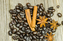 Roasted coffee beans whit cinnamon stick and anise star Stock Images