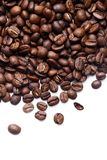 Roasted coffee beans. On white background royalty free stock photos