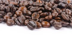 Roasted coffee beans  on white background Royalty Free Stock Photo