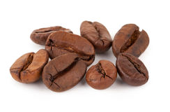 Roasted coffee beans. On white background Stock Photos