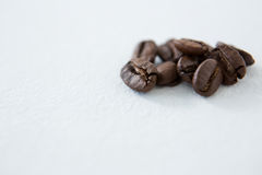 Roasted coffee beans. On white background Royalty Free Stock Photo