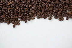 Roasted coffee beans. On white background Stock Image