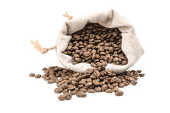 Roasted coffee beans on a white background. Clipping path. Brown coffee isolated on a white background cutout Stock Images