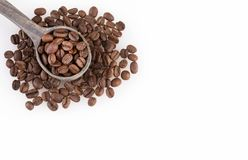 Roasted coffee beans on white background - Coffea. Coffee can help prevent some diseases and contribute to keep in shape the memory and increase the physical and Stock Photography