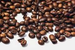 Roasted coffee beans  on white background. With copy space. Frame for creative concepts or advertising Royalty Free Stock Images