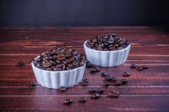 Roasted coffee beans in white bowl porcelain Royalty Free Stock Images