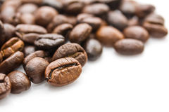 Roasted coffee beans on white Royalty Free Stock Photos
