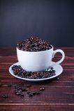Roasted coffee beans in white coffee cup Stock Photo