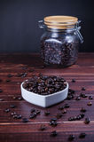 Roasted coffee beans in white heart bowl porcelain Stock Photos