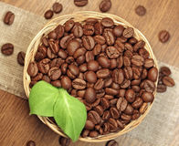 Roasted coffee beans in wicker basket Royalty Free Stock Image