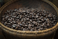 Roasted  coffee beans in the wicker basket. Stock Photography