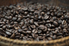 Roasted coffee beans in the  wicker basket. Royalty Free Stock Images