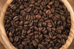 Roasted coffee beans in wood bowl Royalty Free Stock Images