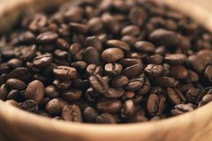 Roasted coffee beans in wood bowl on table Stock Photography