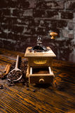 Roasted Coffee Beans, Wood Spoon and Hand Grinder Stock Image