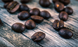 Roasted coffee beans on wood Stock Photography