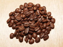 Roasted Coffee Beans on wood texture Royalty Free Stock Photos