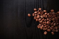 Roasted coffee beans on wood vintage background. Coffee design background. stock photography