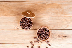 Roasted coffee beans. On a wooden background Royalty Free Stock Photos